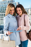 Mother and daughter looking at the tablet Stock Image