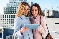 Mother and daughter looking at the tablet Royalty Free Stock Photos