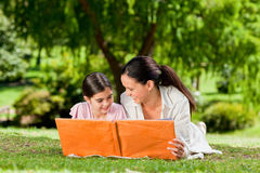 Mother and daughter looking at their album photo Royalty Free Stock Images