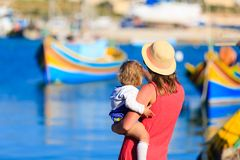 Mother and daughter looking at traditional boats Stock Image
