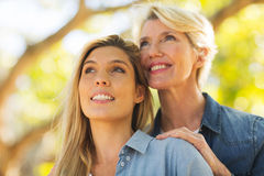 Mother daughter looking up Stock Image