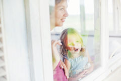 Mother and daughter looking through the window Royalty Free Stock Photos