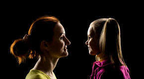 Mother and daughter looks at each other Royalty Free Stock Photos