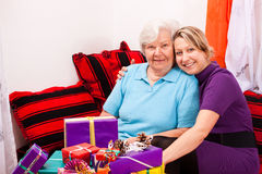 Mother and daughter with a lot of gifts Stock Photography