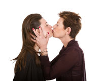 Mother and daughter lovely kiss stock photo