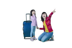 Mother and daughter with luggage on studio Royalty Free Stock Photos
