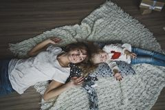 On top of the photo lying on the carpet of people 7345. Mother and daughter lying on the carpet head to head Stock Image