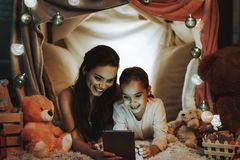 Mother and Daughter Using a Tablet PC stock photo