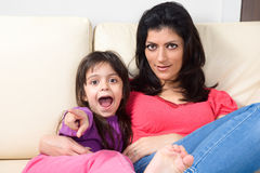 Mother and daughter lying on the couch Royalty Free Stock Images