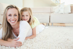 Mother and daughter lying on the floor Royalty Free Stock Photos
