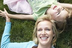 Mother And Daughter Lying On Grass Royalty Free Stock Images