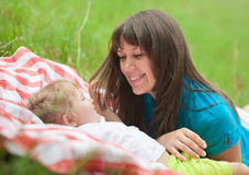 Mother and daughter lying together Stock Photos
