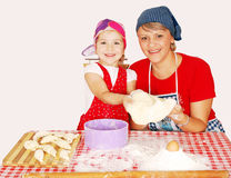 Mother and daughter make croissants Royalty Free Stock Image