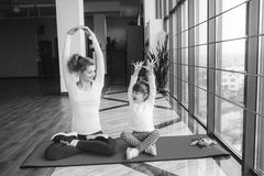 Mother and daughter makeing yoga Royalty Free Stock Image
