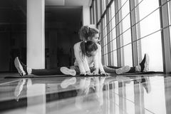 Mother and daughter makeing yoga in the gym Stock Photos