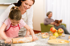 Mother and daughter making apple tart together Stock Images