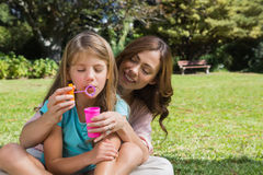 Mother and daughter making bubbles Royalty Free Stock Images