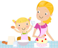 Mother and daughter making a cake. Royalty Free Stock Photos