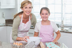 Mother and daughter making cake together Stock Photography