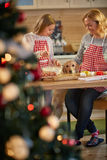 Mother and daughter making cookies for Christmas Stock Photos