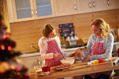 Mother and daughter making cookies for Christmas eve Royalty Free Stock Photo