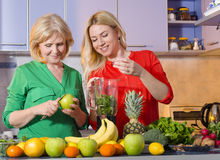 Mother and daughter making fresh juice Stock Photography