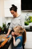 Mother and daughter making gingerbread cookies at home Stock Photography