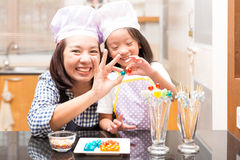 Mother and daughter making jelly ball Royalty Free Stock Photography