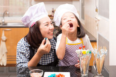 Mother and daughter making jelly ball Stock Photography