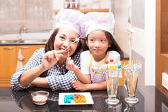 Mother and daughter making jelly ball Stock Image