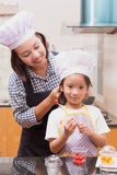 Mother and daughter making jelly candy Stock Photo