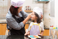 Mother and daughter making jelly candy Royalty Free Stock Photo