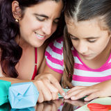 Mother and daughter making origami Royalty Free Stock Photos
