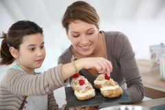 Mother and daughter making pastries at home Stock Photos
