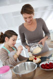 Mother and daughter making pastries Royalty Free Stock Photos