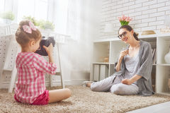 Mother and daughter making photo Stock Photos