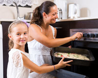 Mother and daughter making pizza Royalty Free Stock Photo