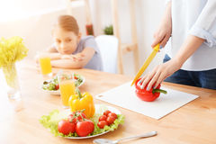 Mother and daughter making salad Royalty Free Stock Photography