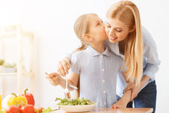 Mother and daughter making salad Stock Photos