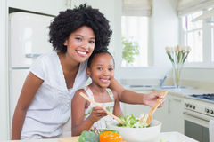 Mother and daughter making a salad together Royalty Free Stock Photo