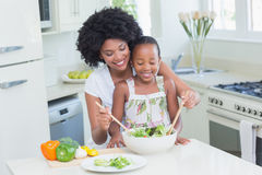 Mother and daughter making a salad together Stock Photos