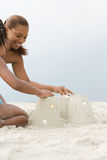 Mother and daughter making sandcastles Royalty Free Stock Photo