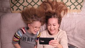 Mother and daughter making selfies on cell phone stock footage