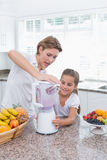 Mother and daughter making a smoothie Royalty Free Stock Image