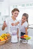 Mother and daughter making a smoothie Royalty Free Stock Images