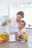 Mother and daughter making a smoothie Stock Photo