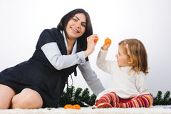 Mother and DAughter with Mandarines Royalty Free Stock Photos