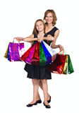 Mother and daughter with many colorful bags Stock Photo