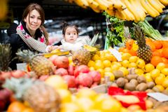 Mother and daughter at the market Stock Photos