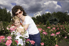 Mother and daughter in meadow Stock Images
